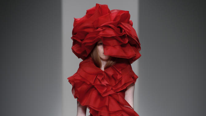 A model wears a design created by John Rocha during London Fashion Week Autumn/Winter 2014, at Somerset House in central London, Saturday, Feb. 15, 2014. (Photo by Jonathan Short/Invision/AP)