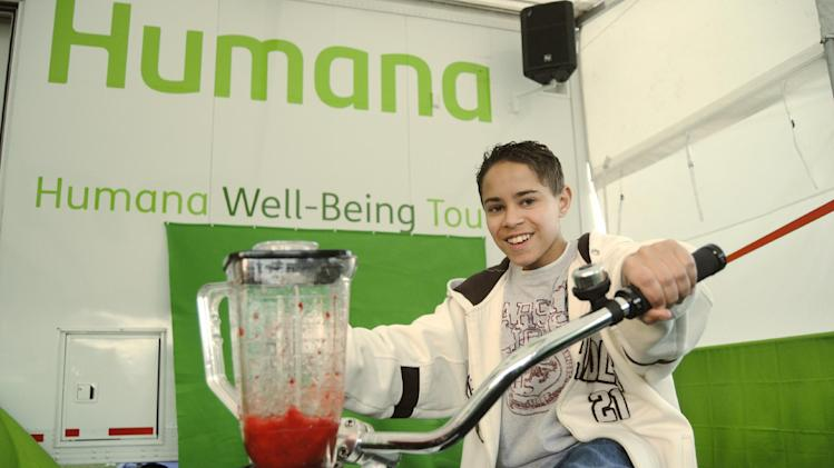 "IMAGE DISTRIBUTED FOR HUMANA- A child uses ""pedal power"" to create a fresh fruit smoothie at the Humana Well-Being Tour during the Humana Challenge First Tee Master Class on Monday, January 14, at PGA West in La Quinta, Calif. The First Tee Master Class gave approximately 40 local children a behind-the scenes look at the 2013 Humana Challenge, including tours of the media center, Bob Hope Square and the Humana Well-Being Tour, as well as the chance to participate in a drill on the driving range. The 2013 Humana Challenge PGA TOUR golf tournament is being held Jan. 14-20, 2013, in La Quinta, Calif.  (Carlos Puma / AP Images for Humana)"