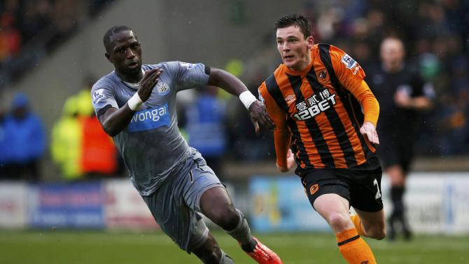 Newcastle United's Moussa Sissoko is challenged by Hull City's Andrew Robertson during their English Premier League soccer match at the KC Stadium in Hull