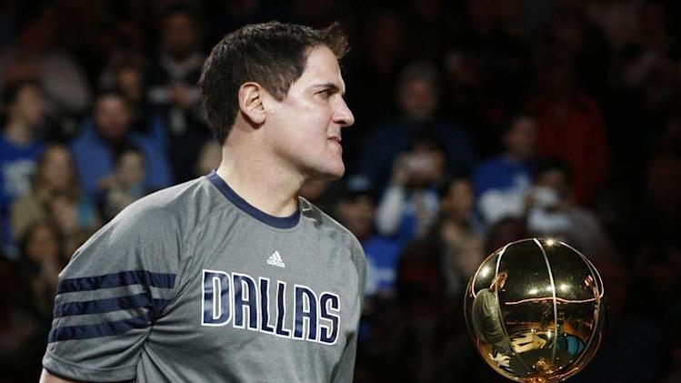 Mavericks owner Cuban holds the Larry O'Brien Championship trophy during a ceremony before their NBA basketball game with the Miami Heat in Dallas, Texas