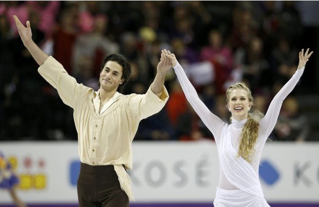 Weaver and Poje of Canada wave to the crowd after performing their ice dance free dance at the ISU World Figure Skating Championships in London, Ontario