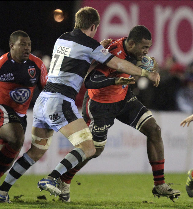 Newcastle Falcons' Will Welch (L) tackles Toulon's Seva Rokobaro (R) during a pool 2, European Challenge Cup rugby union match at Kingston Park, Newcastle upon Tyne, England, on December 08, 2011. AFP