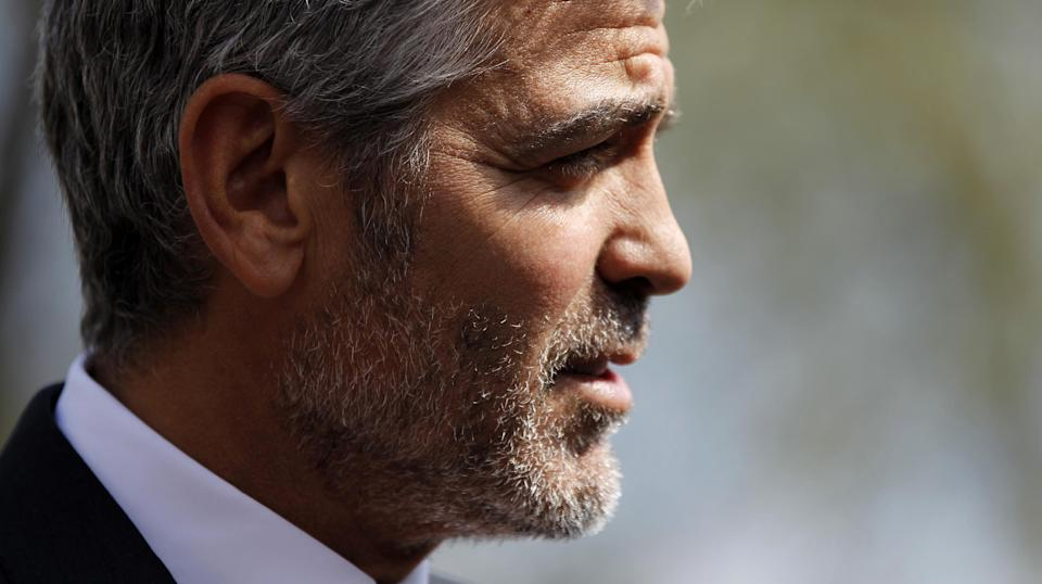 Actor George Clooney speaks to reporters outside the White House in Washington, Thursday, March 15, 2012, after a meeting with President Barack Obama. (AP Photo/Pablo Martinez Monsivais)