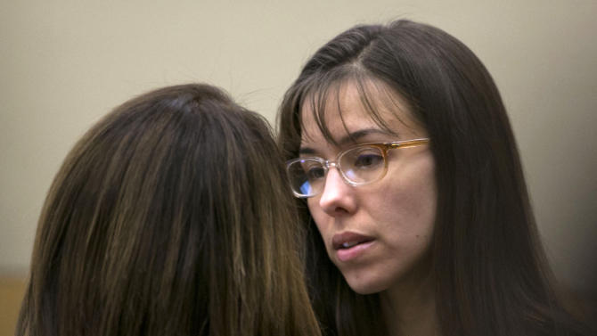 FILE - In a Thursday, April 11, 2013 file photo, Jodi Arias, right, talks to her attorney, Jennifer Wilmott, during her murder trial in Phoenix. Dozens of enthusiasts flock to court each day for a chance to score one of a handful of seats open to the public in Arias' ongoing murder case in Arizona. The tickets are given out on a first-come, first-served basis, and nearly four months into the trial, the crowds are growing.  This week, one trial regular sold her spot to another person for $200 _ and both got reprimands from the court on Tuesday, April 23, 2013. (AP Photo/The Arizona Republic, David Wallace, Pool)