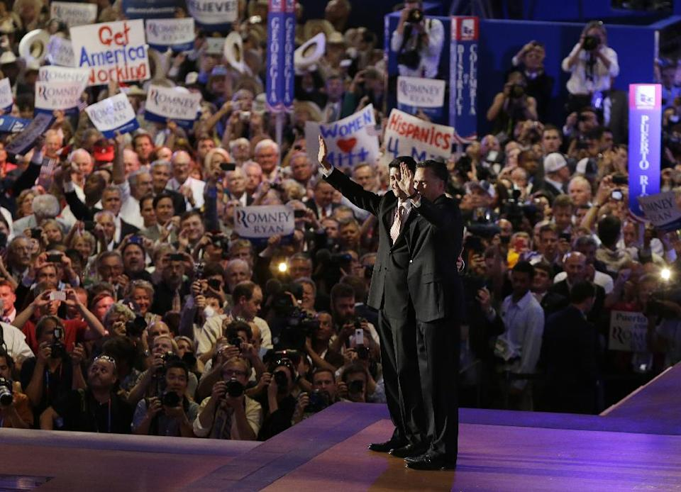 Republican vice presidential nominee, Rep. Paul Ryan, left and Republican presidential nominee Mitt Romney waves to delegates after his speech at the Republican National Convention in Tampa, Fla., on Thursday, Aug. 30, 2012. (AP Photo/Lynne Sladky)