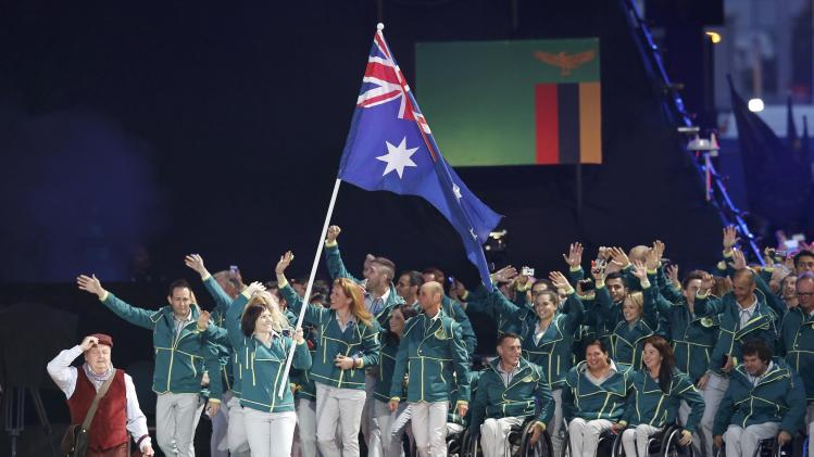 The flag of Australia is carried by Anna Meares during the opening ceremony for the 2014 Commonwealth Games at Celtic Park in Glasgow, Scotland