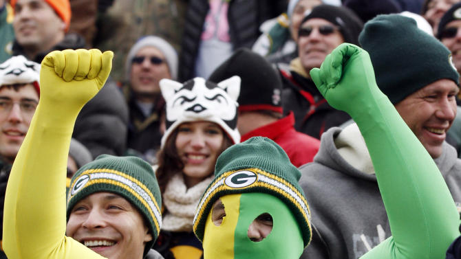 A Green Bay Packers fan celebrates during the first half of an NFL football game against the Tampa Bay Buccaneers Sunday, Nov. 20, 2011, in Green Bay, Wis. (AP Photo/Jeffrey Phelps)