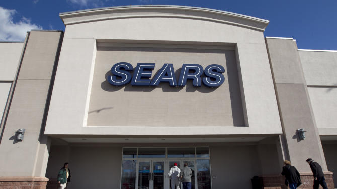 In this Feb. 22, 2012 photo, shoppers enter a Sears department store location in Dedham, Mass.  Sears Holdings said Thursday, Feb. 23, 2012, it will separate its smaller hometown stores, outlets and some hardware stores in a deal expected to raise $400 million to $500 million as it seeks to regain profitability and market share. (AP Photo/Steven Senne)