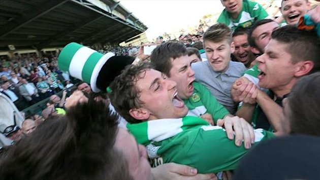 Ed Upson, centre, is mobbed by fans after scoring the goal that sent Yeovil to Wembley
