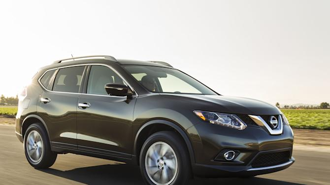 This undated product image provided by Nissan North America shows the 2014 Nissan Rogue small SUV. American car buyers came out of hibernation in April to spend on pickup trucks and SUVs, fueling an auto sales rebound that analysts expect to last the rest of the year. Nissan led the way with an 18.3 percent increase over a year ago, with sales of the redesigned Rogue up almost 27 percent. (AP Photo/Nissan North America)