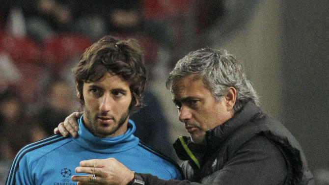 Real Madrid coach Jose Mourinho, right talks to Real player Esteban Granero, left, prior to the group D Champions League soccer match between Ajax and Real Madrid at ArenA stadium in Amsterdam, Netherlands, Wednesday, Dec. 7, 2011. (AP Photo/Peter Dejong)