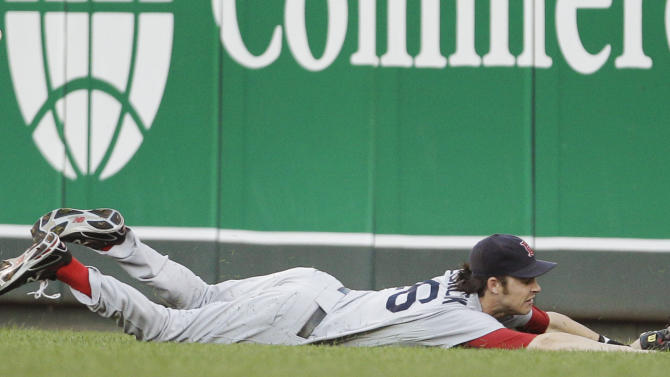 Boston Red Sox right fielder Josh Reddick (16) dives for and misses a fly ball off the bat of Kansas City Royals' Billy Butler during the third inning of a baseball game in Kansas City, Mo., Saturday, Aug. 20, 2011. (AP Photo/Orlin Wagner)