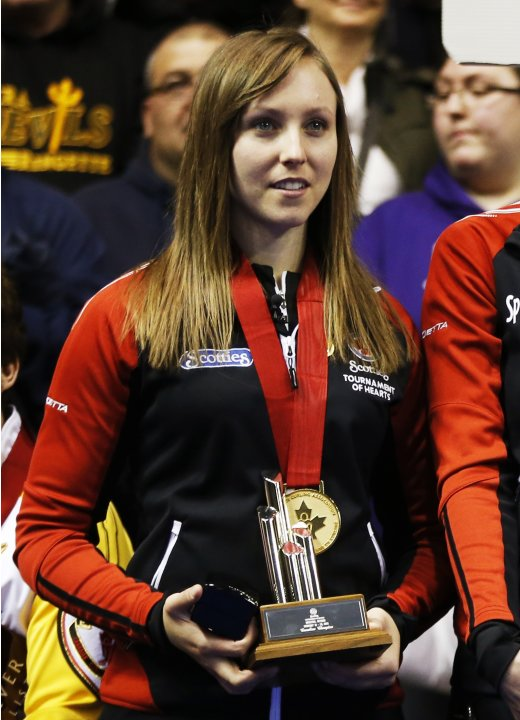 Ontario skip Homan stands with her medal after defeating Manitoba to win their gold medal game at the Scotties Tournament of Hearts curling championship in Kingston