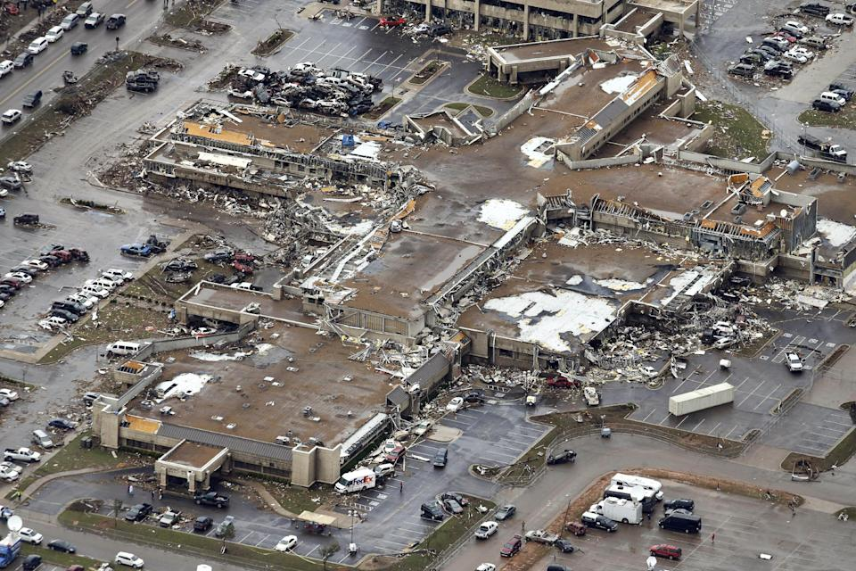 This aerial photo shows the damaged Moore Medical Center after it was struck by Monday's tornado Tuesday, May 21, 2013, in Moore, Oklahoma. The huge tornado roared through the Oklahoma City suburb Monday, flattening entire neighborhoods and destroying an elementary school with a direct blow as children and teachers huddled against winds. (AP Photo/Tony Gutierrez)
