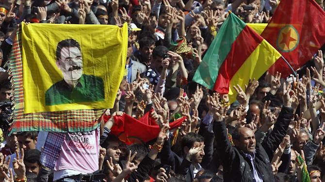 Some thousands of supporters demonstrate waving various PKK flags and images of jailed Kurdish rebel leader Abdullah Ocalan, in southeastern Turkish city of Diyarbakir, Turkey, Thursday, March 21, 2013. Ocalan called Thursday for an immediate cease-fire and for thousands of his fighters to withdraw from Turkish territory, a major step toward ending the fighting for self-rule for Kurds in southeastern Turkey, one of the world's bloodiest insurgencies lasting nearly 30-years and costing tens of thousands of lives.(AP Photo)