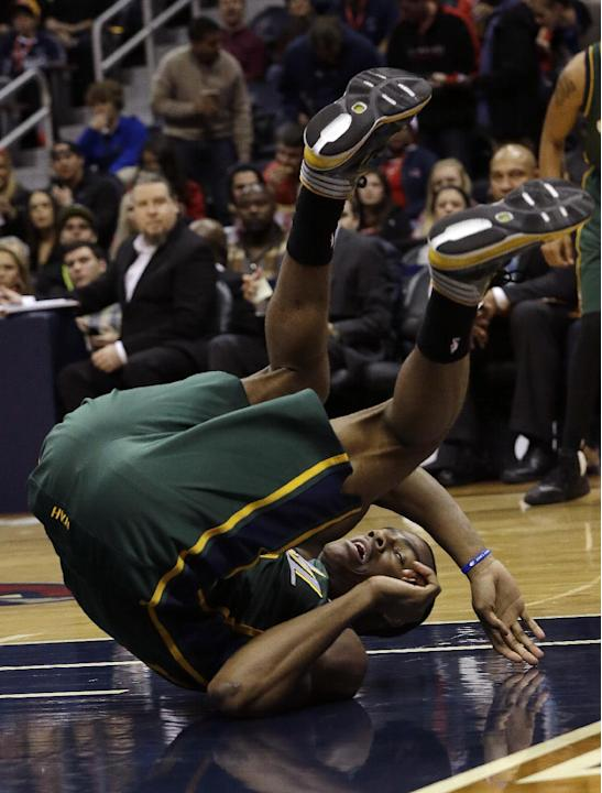 Utah Jazz point guard Alec Burks falls while chasing a loose ball in the first half of an NBA basketball game against the Atlanta Hawks, Friday, Dec. 20, 2013, in Atlanta