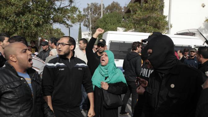 People shout during Tunisia's presidential election in the town of Sousse