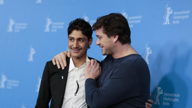 From right, the actors Mohsin Ahmady and Ronald Zehrfeld pose for photographers at the photo call for the film Inbetween Worlds at the Berlinale International Film Festival in Berlin, Tuesday, Feb. 11, 2014. (AP Photo/Markus Schreiber)