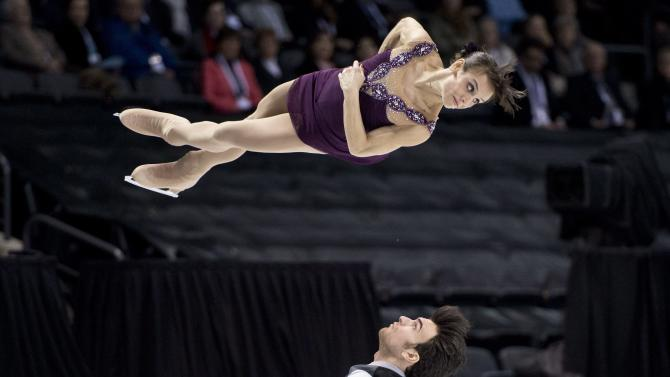 Meagan Duhamel and Eric Radford, of Canada, perform their free skate program in the pairs competition at the World Figure Skating Championships Friday, March 15, 2013 in London, Ontario. (AP Photo/The Canadian Press, Paul Chiasson)