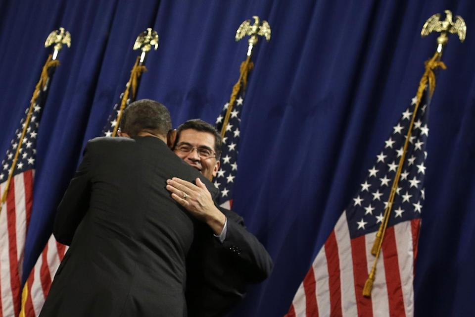 President Barack Obama hugs Rep. Xavier Becerra, D-Calif., before speaking at the House Democratic Issues Conference in Lansdowne, Va., Thursday, Feb. 7, 2013. (AP Photo/Charles Dharapak)