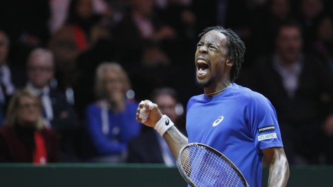 France's Gael Monfils reacts during their Davis Cup final singles tennis match against Switzerland's Roger Federer at the Pierre-Mauroy stadium in Villeneuve d'Ascq, near Lille