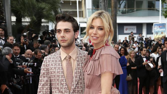 Jury members Xavier Dolan, left, and Sienna Miller pose for photographers upon arrival for the screening of the film Macbeth at the 68th international film festival, Cannes, southern France, Saturday, May 23, 2015. (AP Photo/Thibault Camus)