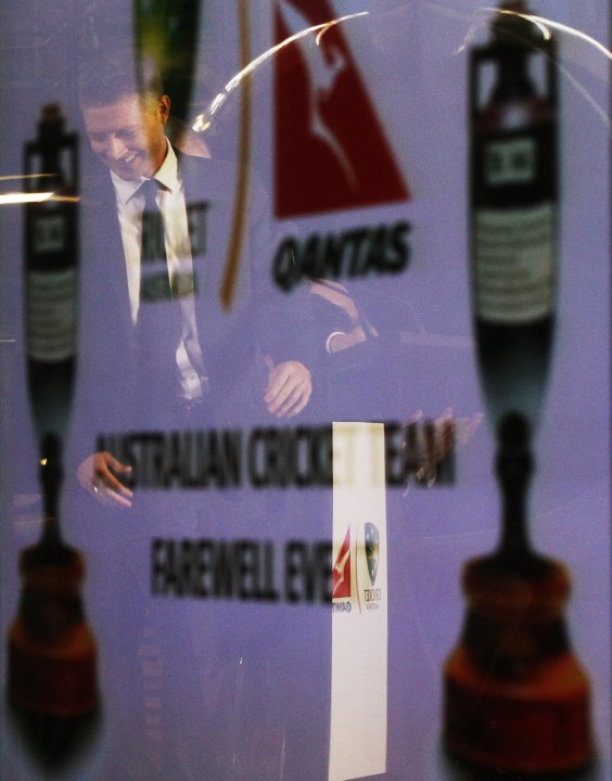 Australia cricket captain Clarke is reflected on a screen during the official team farewell at Sydney airport
