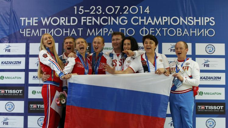 Team Russia celebrate gold in the women's team epee competition at the World Fencing Championships in Kazan