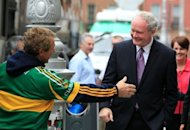 Sinn Fein's Martin McGuinness (right) is greeted by a supporter as he arrives for a news conference. McGuinness, a former commander of the IRA and Northern Ireland's deputy first minister, has been officially confirmed as his party's candidate for next month's Irish presidential election