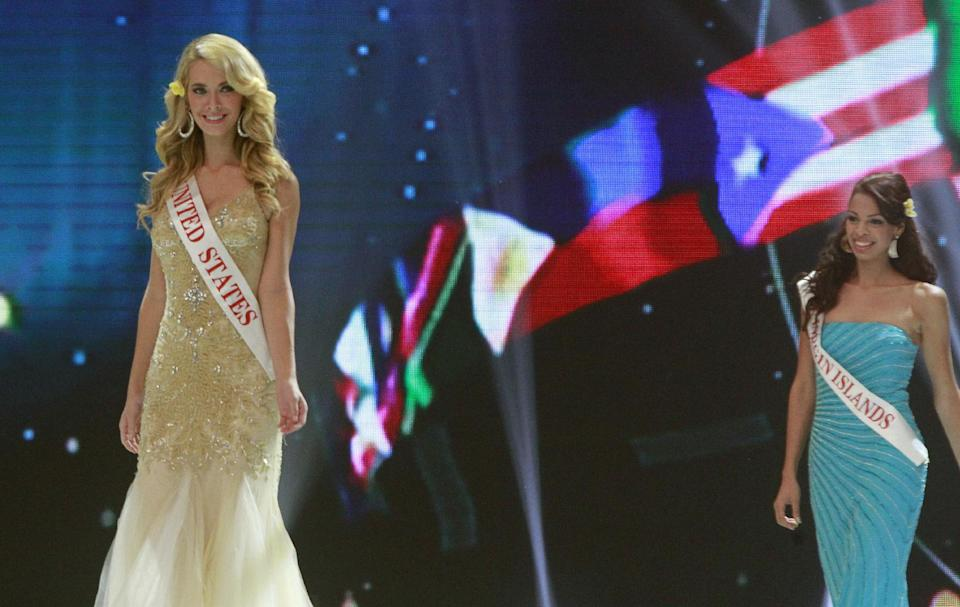 Miss United States Olivia Jordan and Miss US Virgin Island Petra Cabrera Badia walk on stage during opening of the 63rd Miss World Pageant ceremony in Nusa Dua, Bali, Indonesia on Sunday, Sept. 8, 2013. (AP Photo/Firdia Lisnawati)