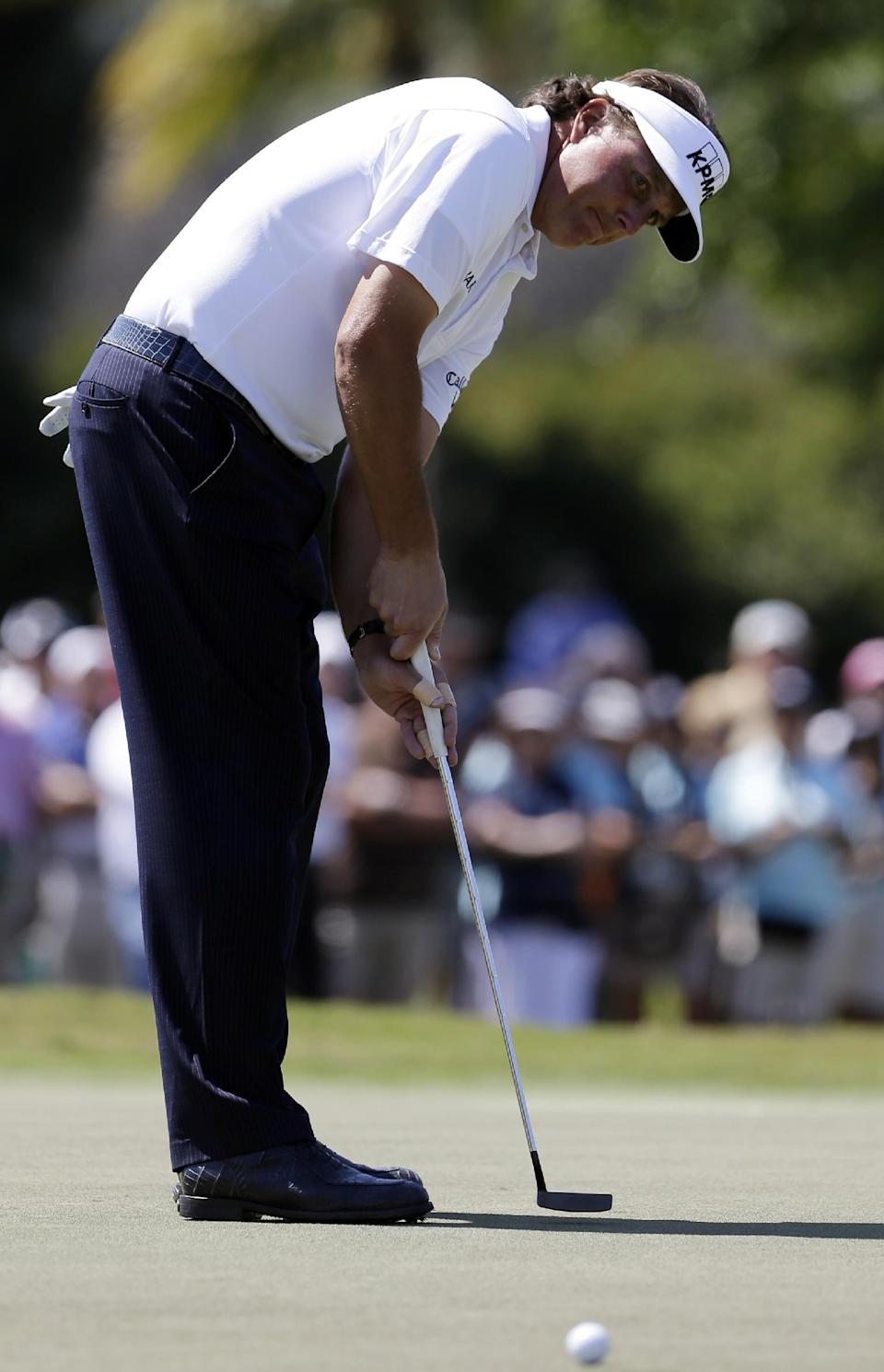 Phil Mickelson watches his putt stop short of the cup on the 11th green during the second round of the Cadillac Championship golf tournament Friday, March 8, 2013, in Doral, Fla. (AP Photo/Alan Diaz)
