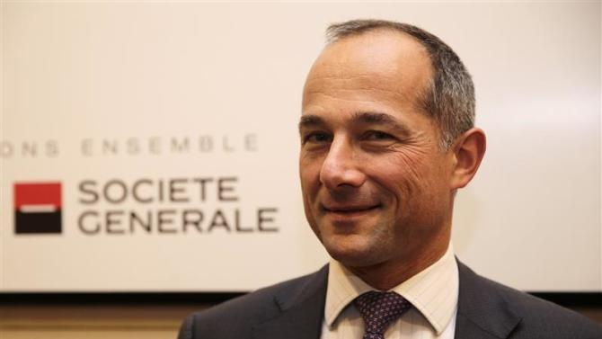 French bank Societe Generale Chairman and Chief Executive Officer Frederic Oudea poses after the company's 2013 annual results presentation in La Defense near Paris
