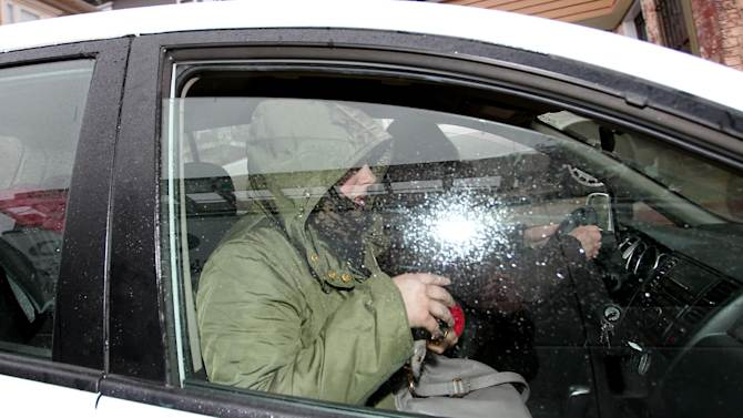 Katherine Tsarnaeva , widow of Boston Marathon bomber suspect Tamerlan Tsarnaev, leaves the law office of DeLuca and Weizenbaum, with her mother Judith Russell, Tuesday, April 23, 2013, Providence, R.I. The attorneys, Amato DeLuca and Miriam Weizenbaum,  issued a statement saying Tsnarnaeva is deeply mourning the bombing victims. They say that Tsarnaeva and her family were in shock when they learned of allegations against her husband and brother-in-law, Dzhokhar Tsarnaev.  (AP Photo/Stew Milne)