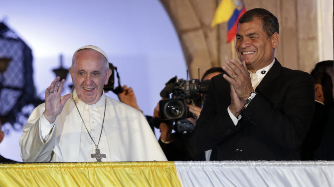 Pope Francis, left, and Ecuador's President Rafael Correa greet the crowd from government palace balcony tin Quito, Ecuador, Monday, July 6, 2015. Francis is making his first visit as pope to his Spanish-speaking neighborhood. He travels to three South American nations, Ecuador, Bolivia and Paraguay. (AP Photo/Dolores Ochoa)