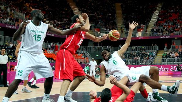 Ike Diogu #6 of Nigeria crashes into Salah Mejri #15 of Tunisia during their Men's Basketball game on Day 2 of the London 2012 Olympic Games at the Basketball Arena on July 29, 2012 in London, England. (Photo by Christian Petersen/Getty Images)
