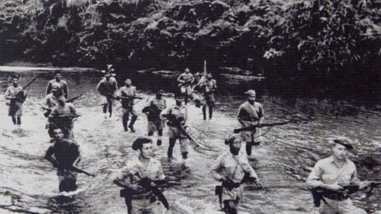 As they wade through a river in northern myanmar during world war ii