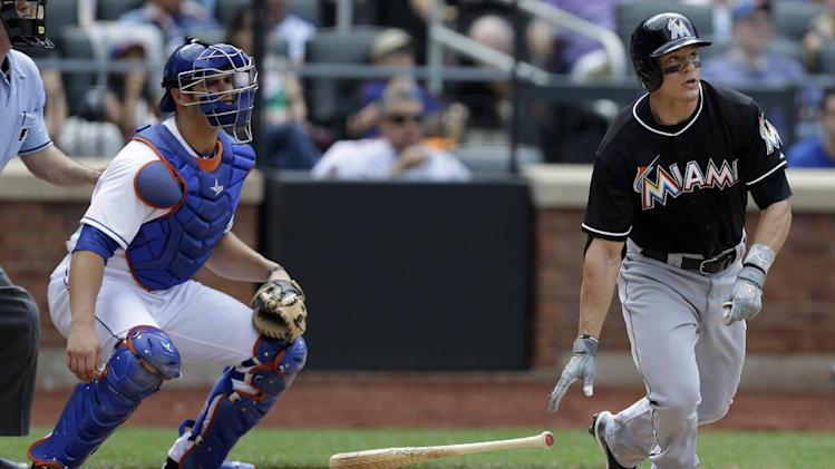 New York Mets catcher Anthony Recker, left, looks on as Miami Marlins' Derek Dietrich hits a game-tying eighth-inning solo home run off Mets pitcher Scott Rice in a baseball game in New York, Sunday, June 9, 2013. (AP Photo/Kathy Willens)