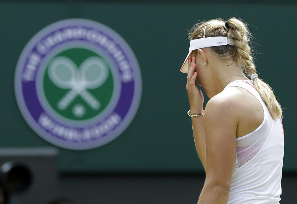 Angelique Kerber of Germany reacts during a semifinals match against Agnieszka Radwanska of Poland at the All England Lawn Tennis Championships at Wimbledon, England, Thursday, July 5, 2012. (AP Photo/Anja Niedringhaus)