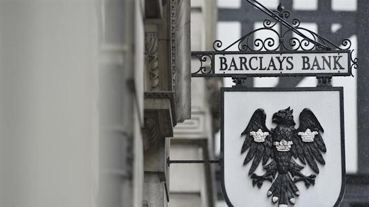 A logo hangs outside a branch of Barclays bank in London July 30, 2013. REUTERS/Toby Melville/Files