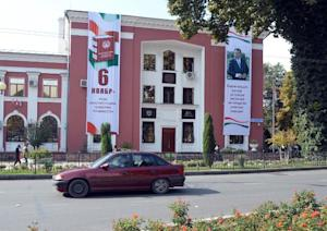 A car passes a polling station in Dushanbe, on November…