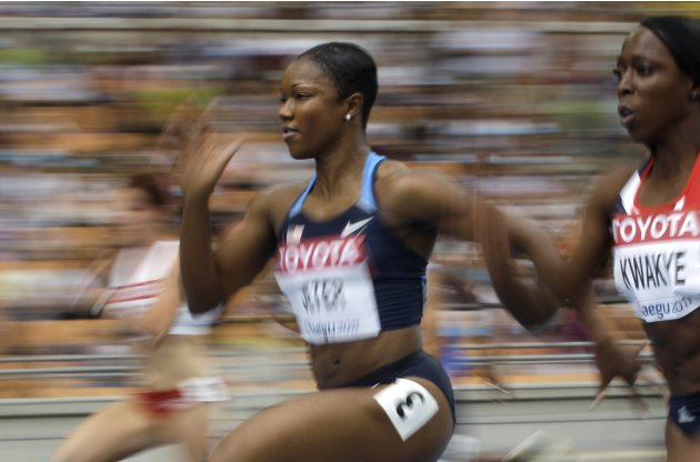 USA's Carmelita Jeter competes in a heat of the women's 100-meter race at the World Athletics Championships in Daegu, South Korea, Sunday, Aug. 28, 2011. Right is Jeanette Kwakye, of Britain. (AP Phot