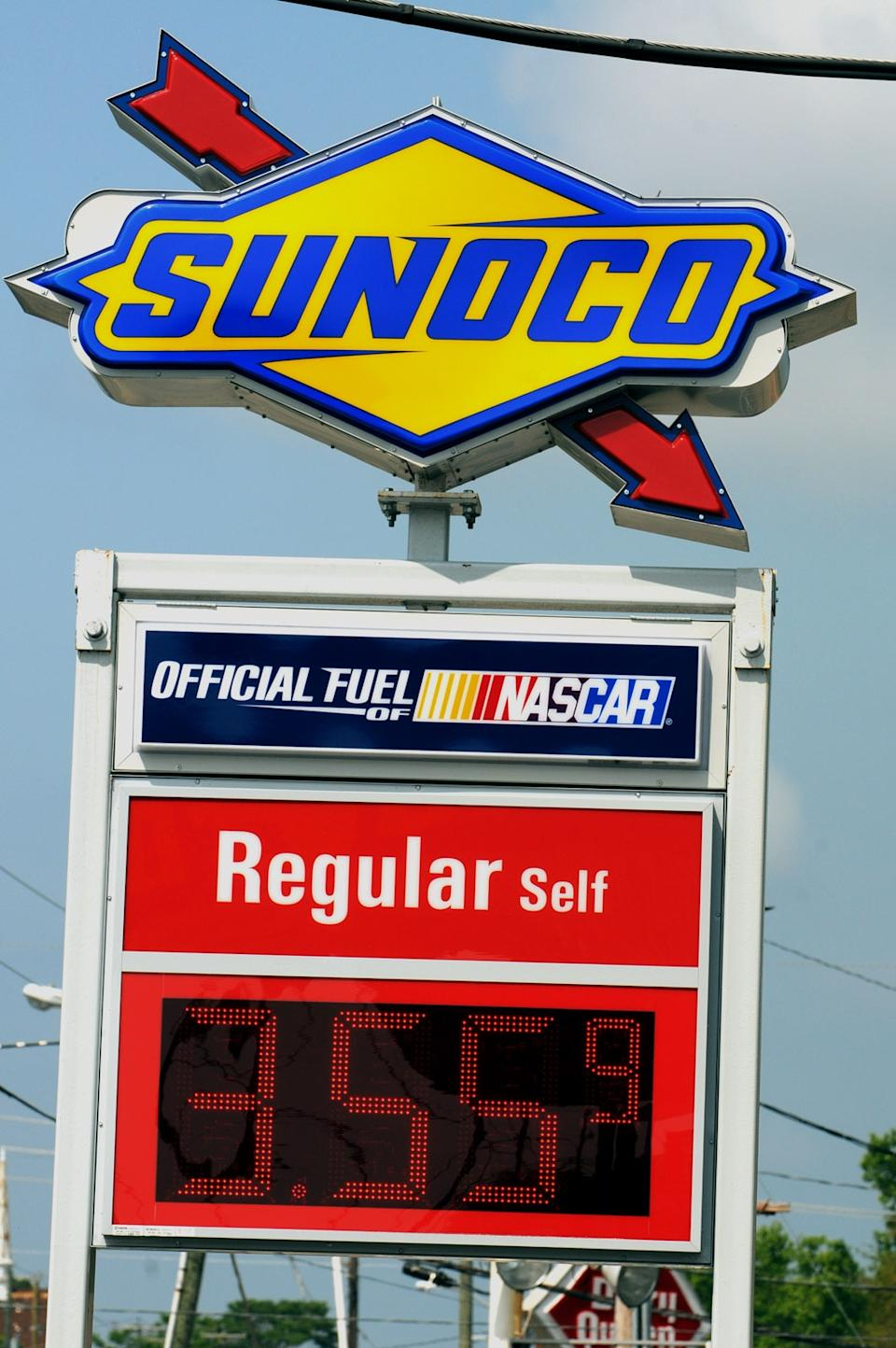 Gas prices appear on a Sunoco station sign located in Wilmington, N.C. on Monday, April 30, 2012. Energy Transfer Partners is buying Sunoco in a $5.3 billion deal that creates one of the more diverse pipeline companies in the country. (AP Photo/Wilmington Star-News, Mike Spencer)