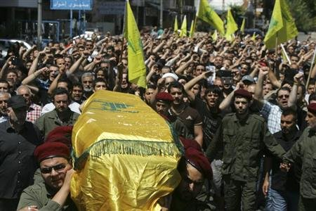 Supporters of Hezbollah and relatives of Hussein Ahmad Abu Hasan , a Hezbollah member ,carry the coffin during his funeral in Beirut's suburbs