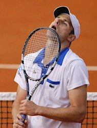 US Andy Roddick reacts as he plays against France's Nicolas Mahut during their Men's Singles 1st Round tennis match of the French Open tennis tournament at the Roland Garros stadium, in Paris. Roddick slumped to a fifth French Open first round defeat when the injury-plagued American lost 6-3, 6-3, 4-6, 6-2 to Mahut