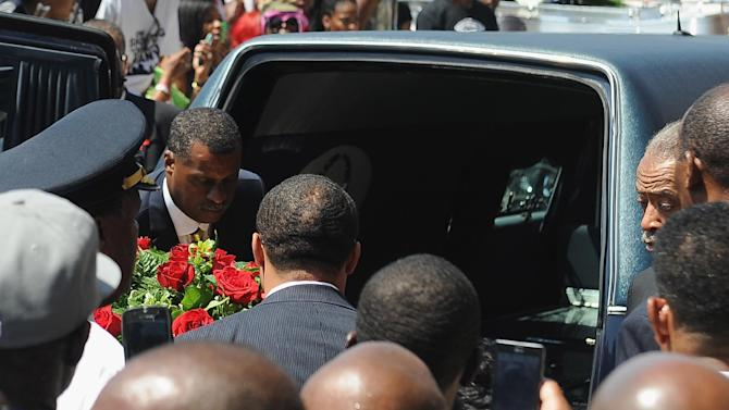 The casket of slain 18-year-old Michael Brown Jr. is loaded into a hearse following his funeral in St. Louis, Missouri, August 25, 2014