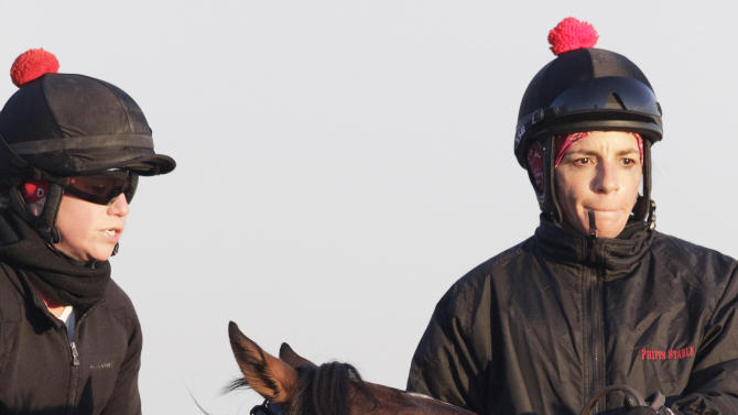 Kentucky Derby winner Orb, with exercise rider Jennifer Patterson aboard, reacts as he enters the track at Belmont Park for a workout, Monday, May 13, 2013 in Elmont, N.Y. Orb is scheduled to travel to Pimlico later in the day to prepare for the Preakness, Saturday, May 18. (AP Photo/Mark Lennihan)