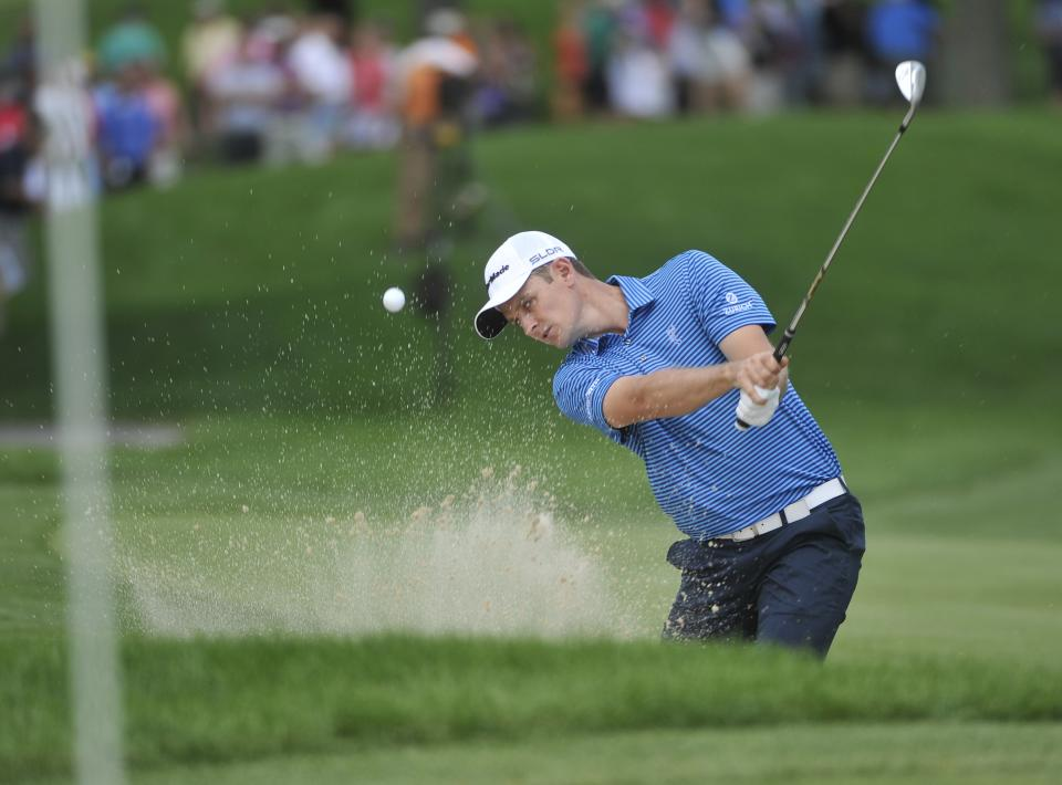 Justin Rose, of England, hits from the sand on the first hole during the first round at the WGC Bridgestone Invitational golf tournament, at Firestone Country Club in Akron, Ohio, Thursday, Aug. 1, 2013. (AP Photo/Phil Long)