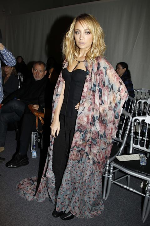 Nicole Richie in a cape