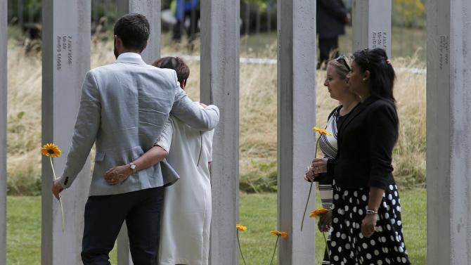 Mourners attend a memorial event to victims of the July 7, 2005 London bombings