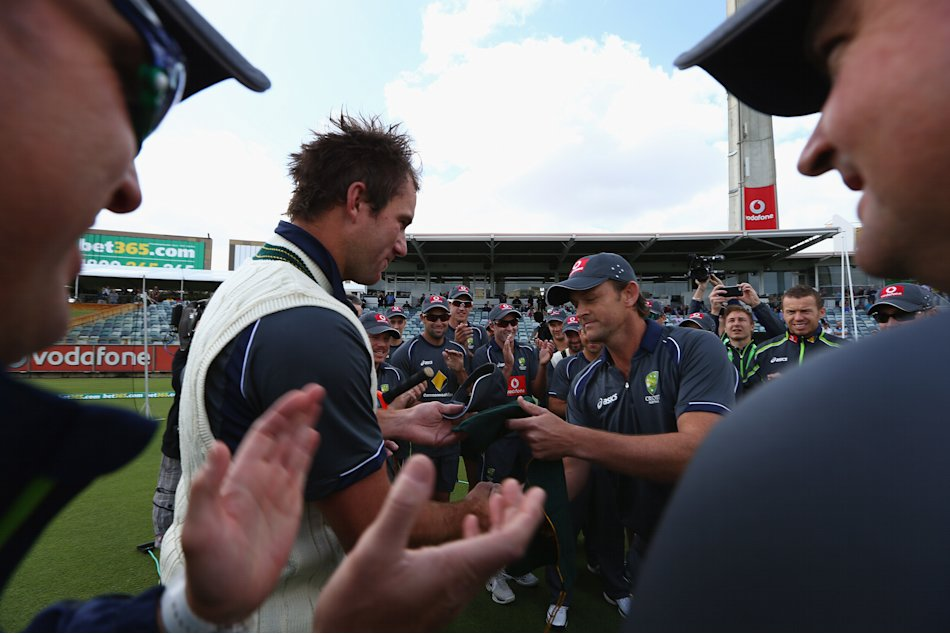 PERTH, AUSTRALIA - NOVEMBER 30: John Hastings of Australia is presented with the baggy green cap by former Australian cricketer Adam Gilchrist prior to the start of play on day one of the Third Test M
